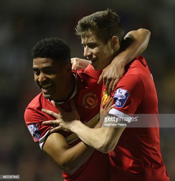 Patrick McNair of Manchester United U21s celebrates scoring their second goal during the Barclays U21 Premier League match between Manchester United...
