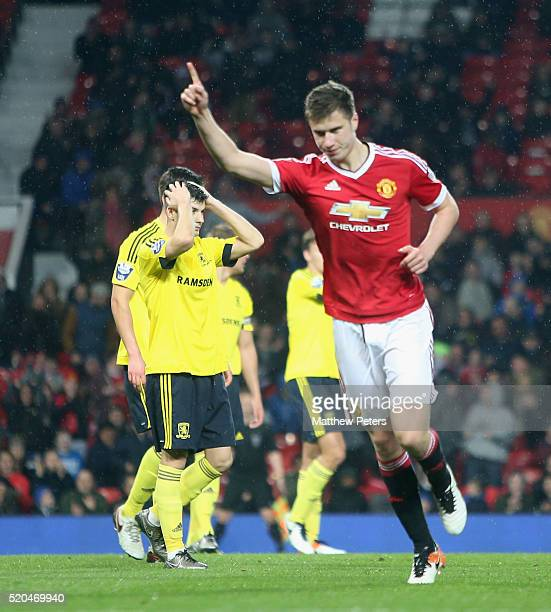 Patrick McNair of Manchester United U21s celebrates scoring their first goal during the Barclays U21 Premier League match between Manchester United...
