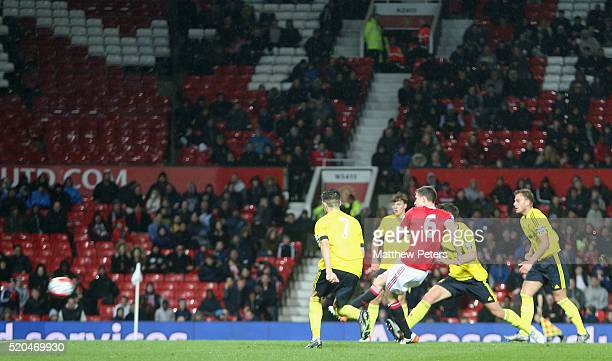 Patrick McNair of Manchester United U21s scores their first goal during the Barclays U21 Premier League match between Manchester United U21s and...