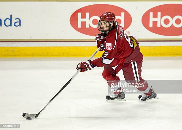 Patrick McNally of the Harvard Crimson controls the puck against the Boston College Eagles during NCAA hockey at Kelley Rink on November 11, 2014 in...