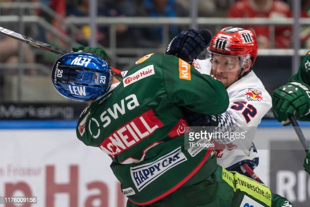 Patrick McNeill of Augsburger Panther and Patrick Hager of EHC Red Bull Muenchen fighting during the DEL match between Augsburger Panther and EHC Red...