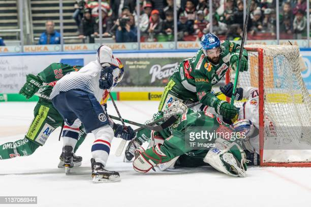 Patrick McNeill of Augsburger Panther Ryan Button of EHC Red Bull Muenchen Scott Valentine of Augsburger Panther goalkeeper Nicolas Hetzel of...