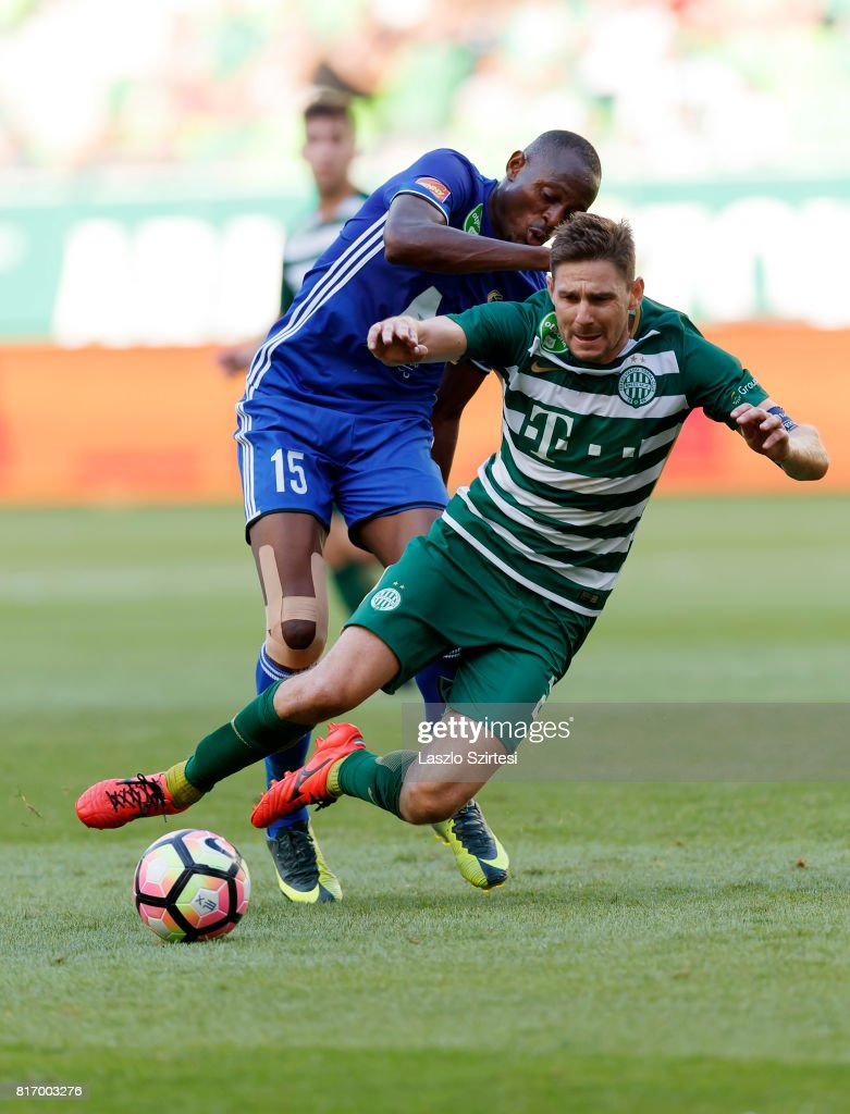 Patrick Mevoungou #15 of Puskas Akademia FC fouls Zoltan Gera (R) of Ferencvarosi TC during the Hungarian OTP Bank Liga match between Ferencvarosi TC and Puskas Akademia FC at Groupama Arena on July 16, 2017 in Budapest, Hungary.