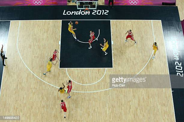 Patrick Mills of Australia shoots the game winning three point shot against Russia in the final seconds of the Men's Basketball Preliminary Round...