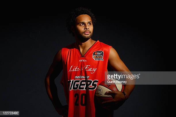 Patrick Mills poses after a Melbourne Tigers NBL press conference at the Melbourne Tigers Training Base on August 29 2011 in Melbourne Australia