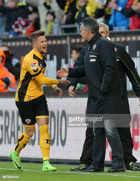 Patrick Moeschl of Dresden jubilates with head coach Uwe Neuhaus after scoring the first goal during the Second Bundesliga match between SG Dynamo...