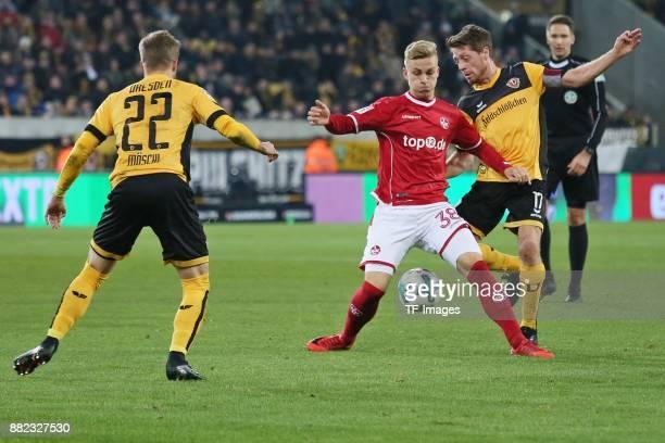 Patrick Moeschl of Dynamo Dresden Nils Seufert of Kaiserslautern and Andreas Lambertz of Dynamo Dresden battle for the ball during the Second...