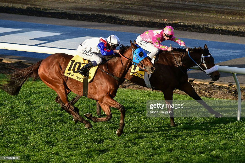 Patrick Moloney riding Digitalism (10) races up to defeat Regan Bayliss riding Kenjorwood (3rd placing) in Race 7 during Melbourne Racing at Moonee Valley Racecourse on June 6, 2015 in Melbourne, Australia.