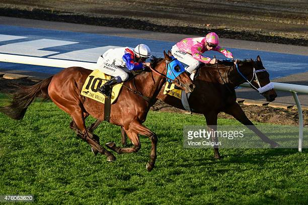 Patrick Moloney riding Digitalism races up to defeat Regan Bayliss riding Kenjorwood in Race 7 during Melbourne Racing at Moonee Valley Racecourse on...
