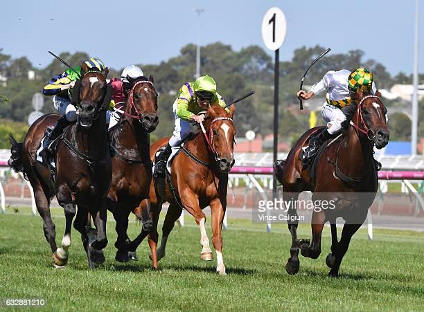 Patrick Moloney riding Tivaci defeats Damien Oliver riding El Divino in Race 7 Kensington Stakes during Melbourne Racing at Flemington Racecourse on...