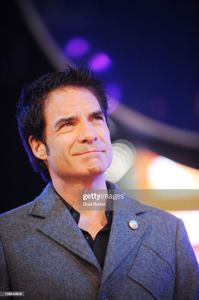 Patrick Monahan of Train performs 'Mermaid' on the NIVEA Kiss Stage in Times Square on New Year's Eve 2013 at Times Square on December 31, 2012 in New York City.