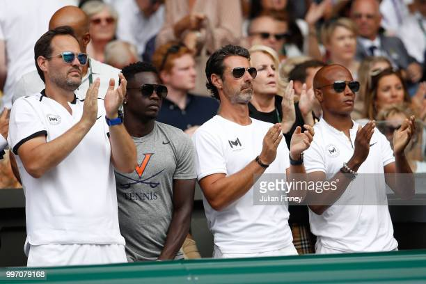 Patrick Mouratoglou coach of Serena Williams of The United States applauds as he watches her compete in the Ladies' Singles semifinal match on day...
