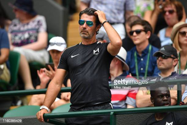 Patrick Mouratoglou coach of Serena Williams of The United States looks on from the stands in the Ladies' Singles third round match between Serena...