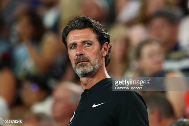 Patrick Mouratoglou coach of Serena Williams of the United States watches her play during her second round match against Eugene Bouchard of Canada...