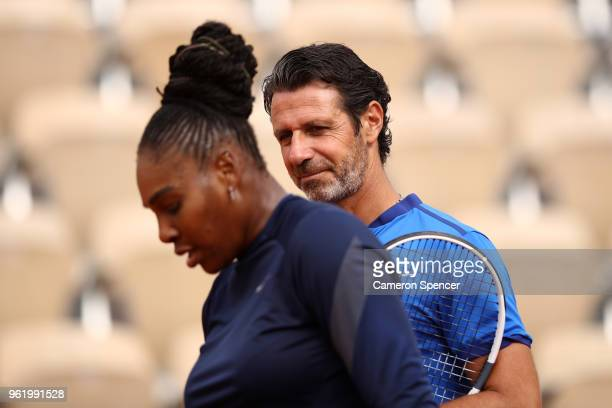 Patrick Mouratoglou coach of Serena Williams of the United States talks to her during a practice session ahead of the French Open at Roland Garros on...