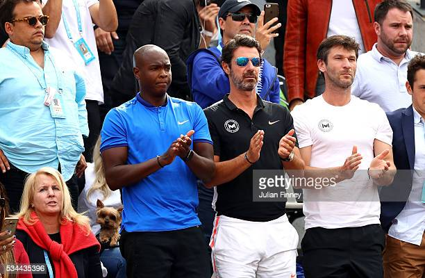 Patrick Mouratoglou the coach coach Serena Williams of the United States applauds her victory during the Ladies Singles second round match against...