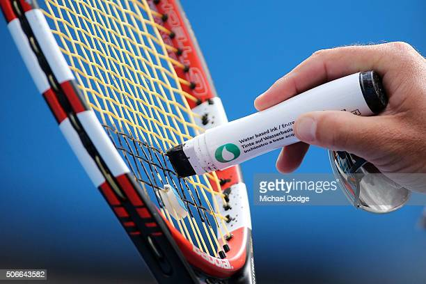 Patrick Mouratoglou the coach of Serena Williams of the United States marks her racquet during a practice session on day eight of the 2016 Australian...