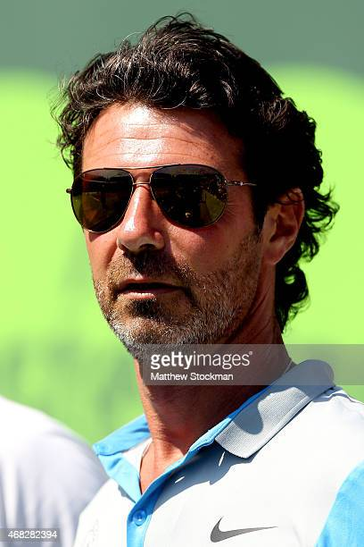 Patrick Mouratoglou watches Serena Williams play Sabine Lisiki of Germany during day 10 of the Miami Open Presented by Itau at Crandon Park Tennis...