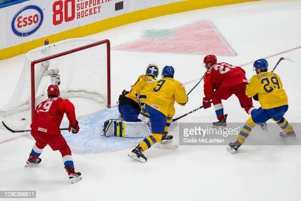 Patrick Moynihan looks on as teammate Marat Khusnutdinov of Russia scres the game-winning goal against goaltender Jesper Wallstedt of Sweden during...