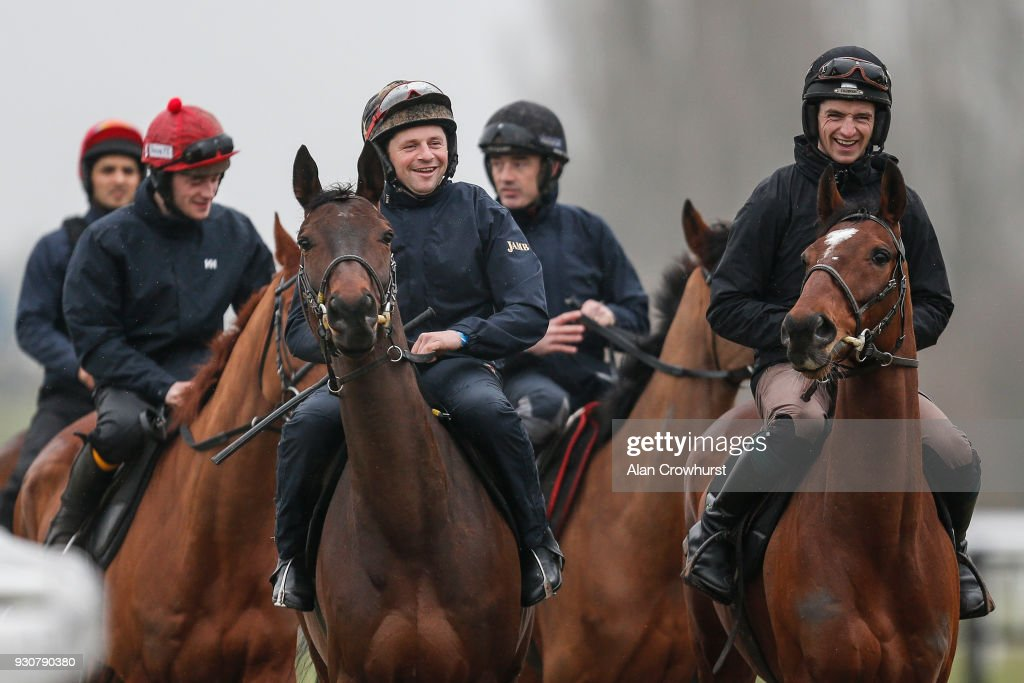 Patrick Mullins (R) shares a joke with Sonny Carey as they make their way to the gallops at Cheltenham racecourse on March 12, 2018 in Cheltenham, England.
