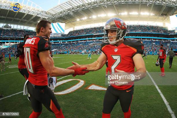 Patrick Murray and Adam Humphries of the Tampa Bay Buccaneers after the win against the Miami Dolphins at Hard Rock Stadium on November 19 2017 in...