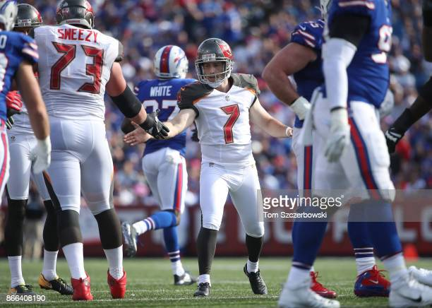 Patrick Murray of the Tampa Bay Buccaneers is congratulated by JR Sweezy after kicking a field goal during NFL game action against the Buffalo Bills...