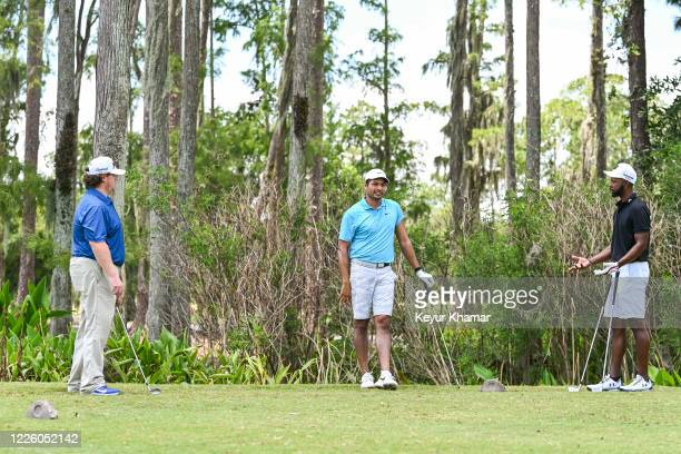 Patrick Newcomb Julian Suri and Tim ONeal speak on the 13th tee box during the final round of an APGA Tour event on the Slammer Squire Course at...