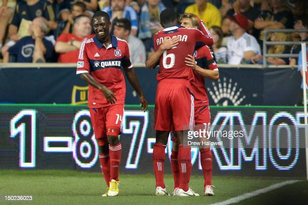 Patrick Nyarko and Jalil Anibaba of the Chicago Fire congratulate teammate Chris Rolfe on a goal during the match against the Philadelphia Union at...