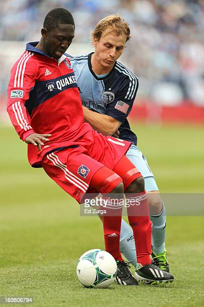 Patrick Nyarko of Chicago Fire and Seth Sinovic of Sporting Kansas City vie for the ball in the first half at Sporting Park on March 16 2013 in...