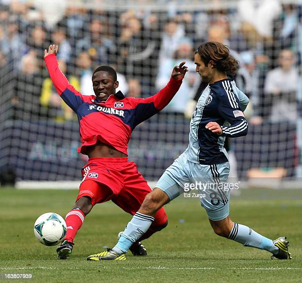Patrick Nyarko of Chicago Fire clears the ball away from Graham Zusi of Sporting Kansas City in the first half at Sporting Park on March 16 2013 in...