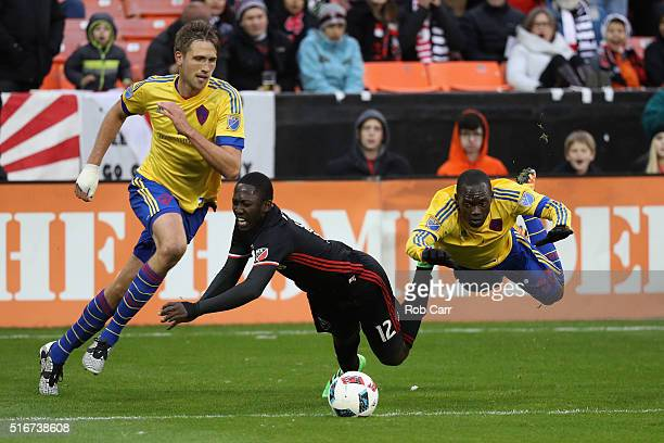 Patrick Nyarko of DC United and Michael Azira of Colorado Rapids get tangled up going after the ball in the second half at RFK Stadium on March 20...