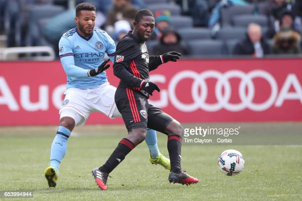 Patrick Nyarko of DC United is challenged by Ethan White of New York City FC during the NYCFC Vs DC United regular season MLS game at Yankee Stadium...