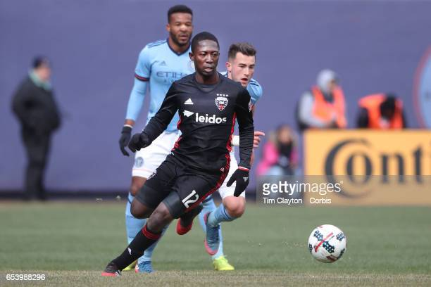 Patrick Nyarko of DC United is challenged by Jack Harrison of New York City FC during the NYCFC Vs DC United regular season MLS game at Yankee...