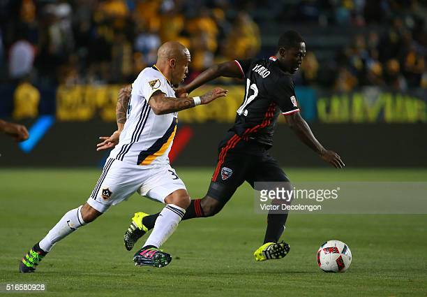 Patrick Nyarko of DC United paces the ball past Nigel de Jong of the Los Angeles Galaxy during the MLS match at StubHub Center on March 6 2016 in...