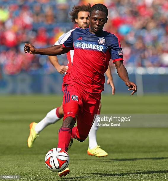 Patrick Nyarko of the Chicago Fire advances the ball in front of Kevin Alston of the New England Revolution during an MLS match at Toyota Park on...