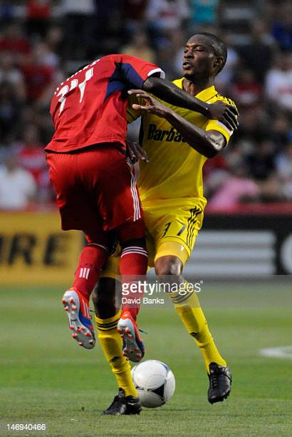 Patrick Nyarko of the Chicago Fire and Kevan George of the Columbus Crew collide during an MLS match on June 23 2012 at Toyota Park in Bridgeview...