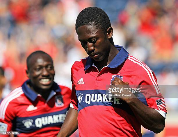 Patrick Nyarko of the Chicago Fire celebrates after scoring a goal against the New York Red Bulls as Dominic Oduro moves to join him during an MLS...