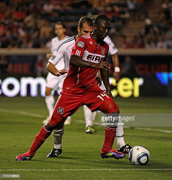 Patrick Nyarko of the Chicago Fire controls the ball under pressure from Daniel Woolard of DC United during an MLS match at Toyota Park on August 18...