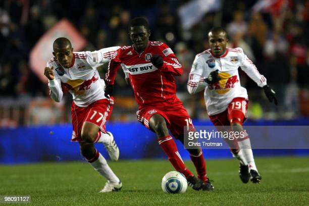Patrick Nyarko of the Chicago Fire out paces Jeremy Hall and Dane Richards of the New York Red Bulls during the match at Red Bull Arena on March 27...