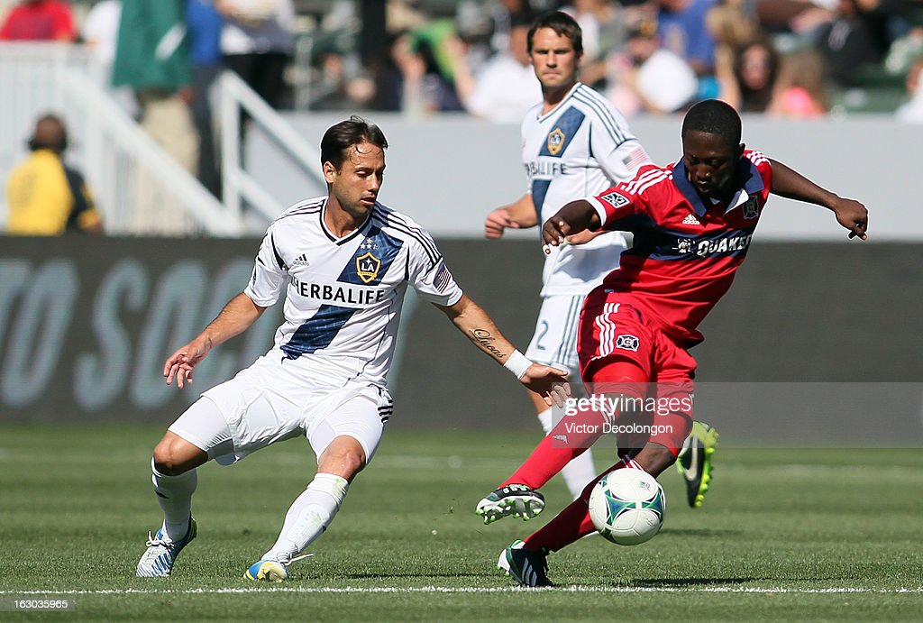 Patrick Nyarko #14 of the Chicago Fire plays the ball away from Marccelo Sarvas #8 of the Los Angeles Galaxy during the MLS match at The Home Depot Center on March 3, 2013 in Carson, California. The Galaxy defeated the Fire 4-0.