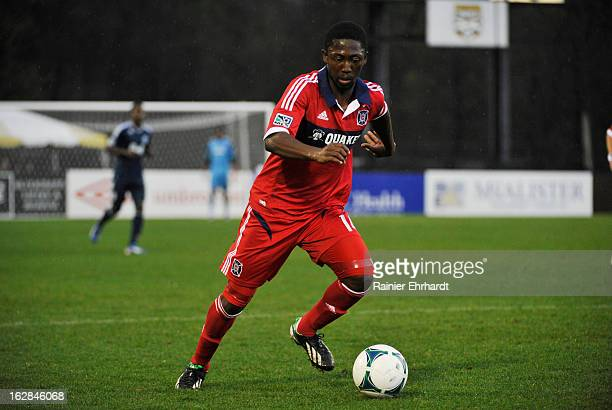 Patrick Nyarko of the Chicago Fire runs with the ball during the first half of the Carolina Challenge Cup against the Vancouver Whitecaps FC at...