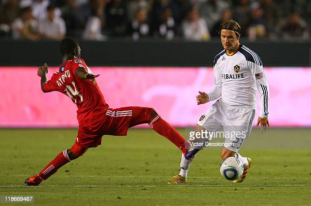Patrick Nyarko of the Chicago Fire stretches to play the ball on defense against David Beckham of the Los Angeles Galaxy during their MLS match at...