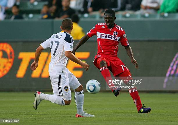 Patrick Nyarko of the Chicago Fire tries to control a volley pass as Bryan Jordan of the Los Angeles Galaxy defends the play in the first half during...