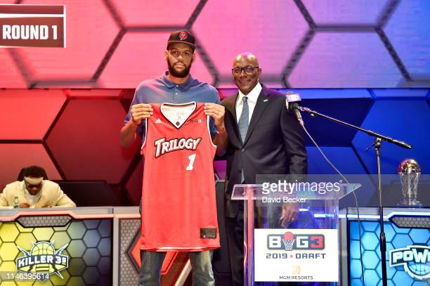 Patrick O'Bryant poses with BIG3 Commissioner Clyde Drexler after being drafted at by the Trilogy in the first round during the BIG3 Draft at the...