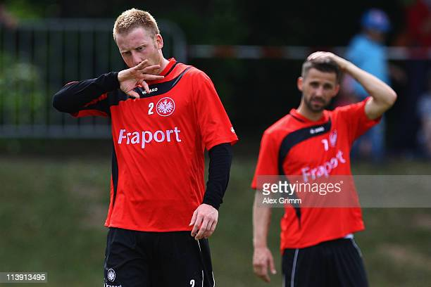 Patrick Ochs and Benjamin Koehler react during a training session of Eintracht Frankfurt at Commerzbank Arena on May 10, 2011 in Frankfurt am Main,...