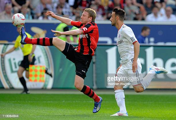 Patrick Ochs of Frankfurt battles for the ball with Diego Contento of Muenchen during the Bundesliga match between Eintracht Frankfurt and FC Bayern...