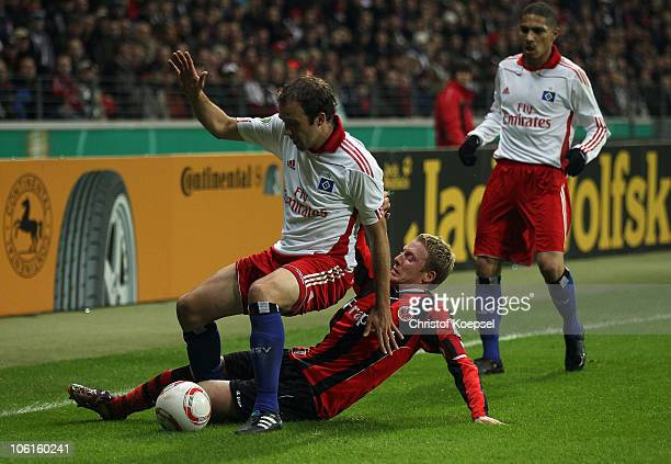 Patrick Ochs of Frankfurt challenges Joris Mathijsen of Hamburg during the DFB Cup match between Eintracht Frankfurt and Hamburger SV at Commerzbank...