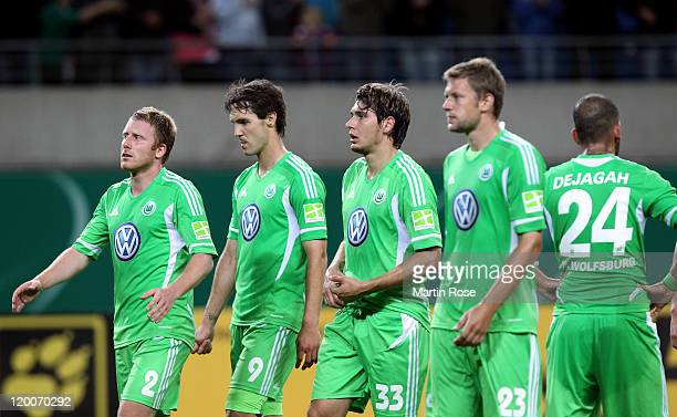 Patrick Ochs Srdjan Lakic Patrick Helmes and Marco Russ of Wolfsburg look dejected after the DFB Cup first round match between RB Leipzig and VfL...