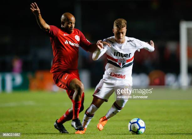 Patrick of Internacional and Lucas Fernandes of Sao Paulo in action during the match for the Brasileirao Series A 2018 at Morumbi Stadium on June 05...