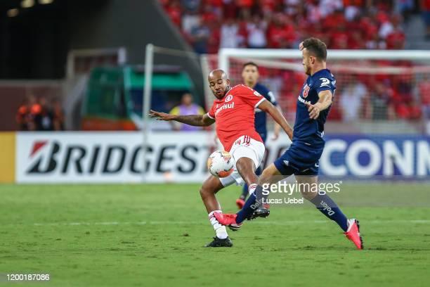 Patrick of Internacional battles for the ball against Ángelo Henríquez of Universidad de Chile during the match between Internacional and Universidad...